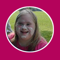 Girl smiling with cream on face